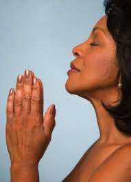 a balck woman praying